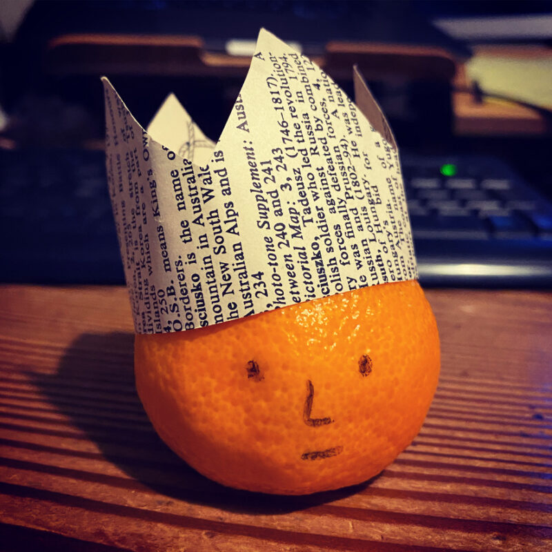 Clementine: drawn on face and a paper crown