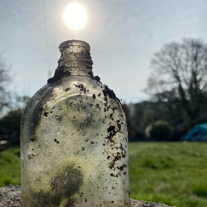 a dirty glass bottle in the sun