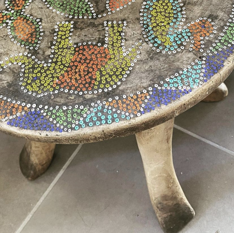 Small table with elephant and duck painting